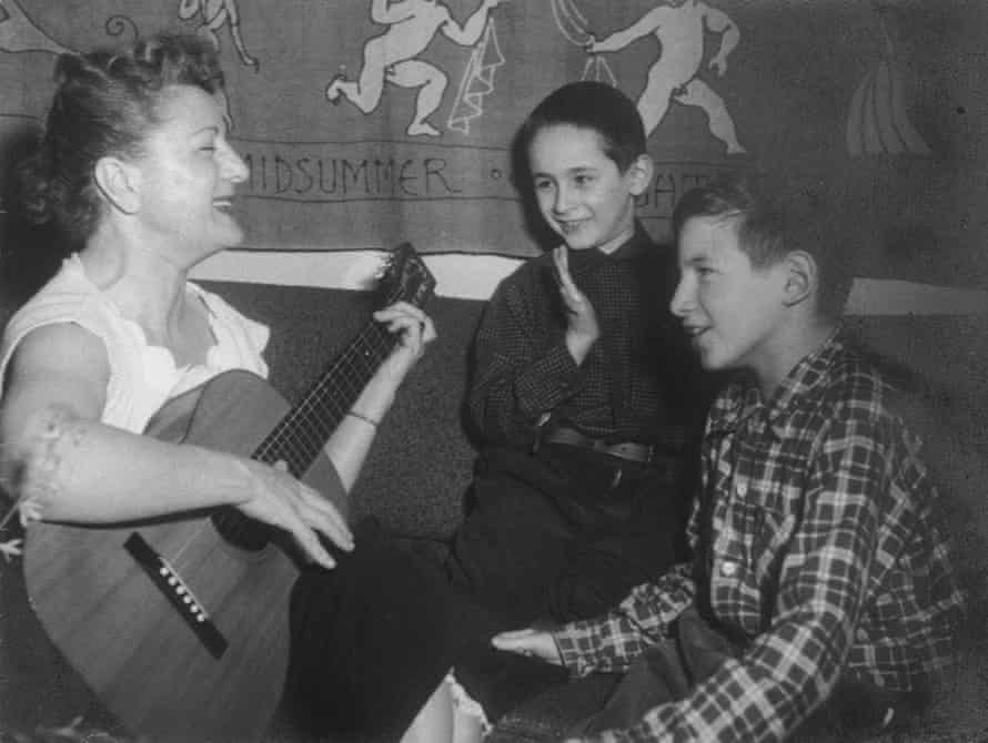 Robert, centre, and Michael, right, with their adoptive mother Anne Meeropol.