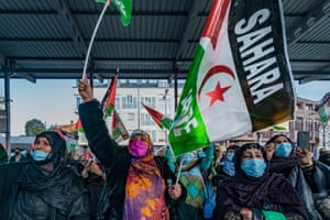 Women wave Sahara flags during a demonstration in support of the recognition of the independence of the self-proclaimed Sahrawi Arab Democratic Republic, in Torrelavega, Spain. They claim the territory is was wrongly occupied by Morocco after Spain, its previous coloniser, left in 1976.
