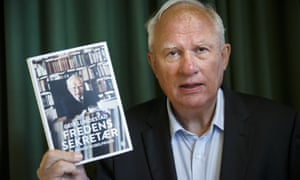 Geir Lundestad holds his book The Peace Secretary at its launch at the Nobel Peace Center in Oslo.
