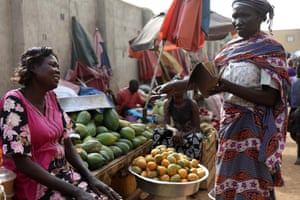 Jacqueline Benjamin, left, at her fruit stall in Juba.