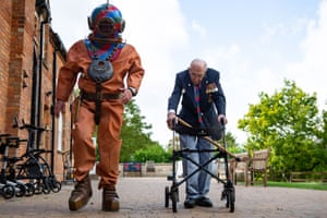 Marston Moretaine, England. Capt Sir Tom Moore walks with the veteran fundraiser Lloyd Scott, who will attempt the Three Peaks challenge wearing a deep sea diving suit