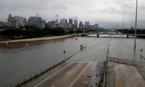 The downtown Houston skyline and flooded highway 288.