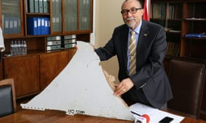 Joao de Abreu, president of Mozambique's Civil Aviation Institute, holds a piece of aircraft wreckage found off the coast of Mozambique