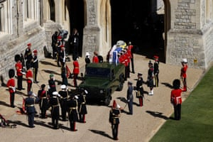 Coffin placed in Land Rover