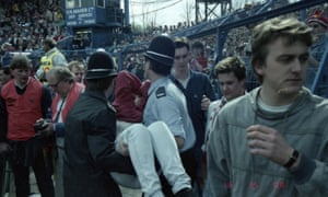 Casualties are carried away after the crush at Hillsborough