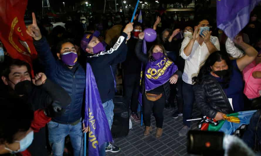 Supporters of leftwing parties celebrate in Santiago after their victories in Chile's constitutional assembly elections.