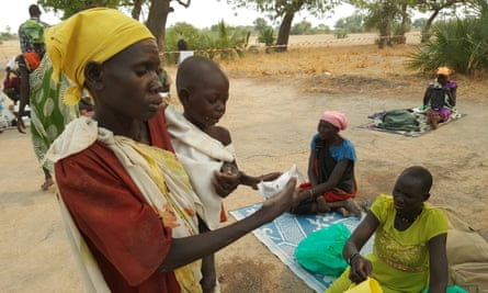 A mother in South Sudan's Unity State, whose child is suffering from severe malnutrition