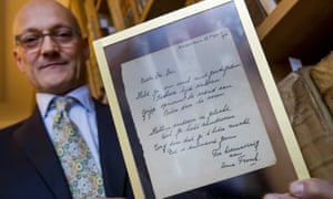 Thijs Blankevoort, director of the Bubb Kuyper auction house, displays the handwritten Anne Frank poem