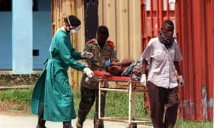 A patient affected by the Ebola virus carried on a stretcher at the Kikwit Hospital, 530km southeast of the Zaire capital Kinshasa, 14 May 1995.