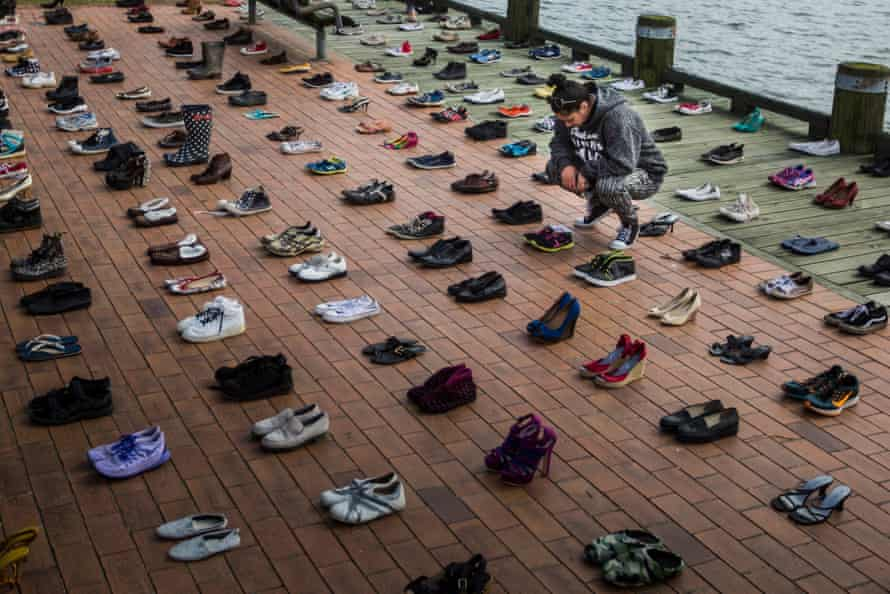 The 606 pairs of shoes represent each person lost in the last year to suicide in New Zealand.