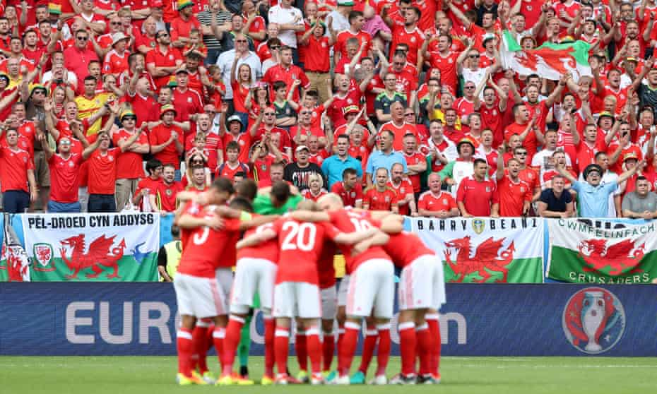 Wales's players form a huddle in front of their fans ahead of the game against Slovakia in Bordeaux at Euro 2016
