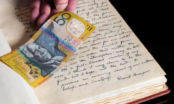 David Unaipon's original handwritten preface to Legendary Tales of the Australian Aborigines and a $50 note the quotation appears on