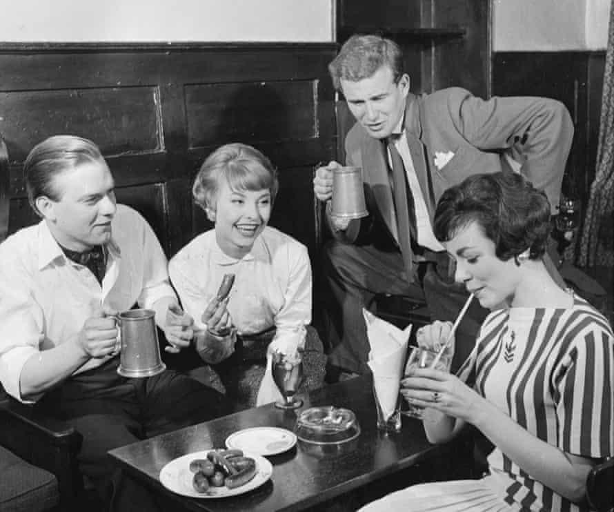 Pub-goers enjoying bar snacks at the Spaniards Inn, north London, in 1958.