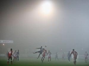 Accrington Stanley's winning goalscorer Omar Beckles challenges Luton's Isaac Vassell in the fog