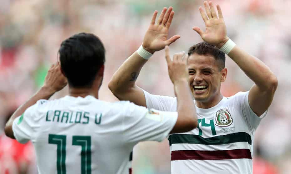 Carlos Vela and Javier Hernández celebrate after Vela gave Mexico the lead from the penalty spot.