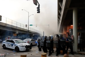 Police in riot gear use teargas at a rally in response to the recent death of George Floyd on 30 May 2020 on the streets of downtown Miami, Florida.