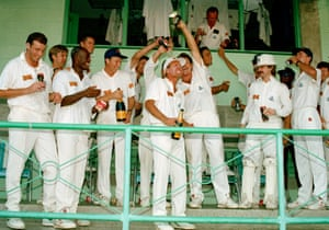 Chris Lewis, third from left, celebrates with England team-mates including Alec Stewart after England beat West Indies in the fourth Test in Barbados in April 1994.