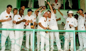 Robin Smith (centre, left arm aloft) celebrates with the England team after their famous win against West Indies at Barbados in 1994.