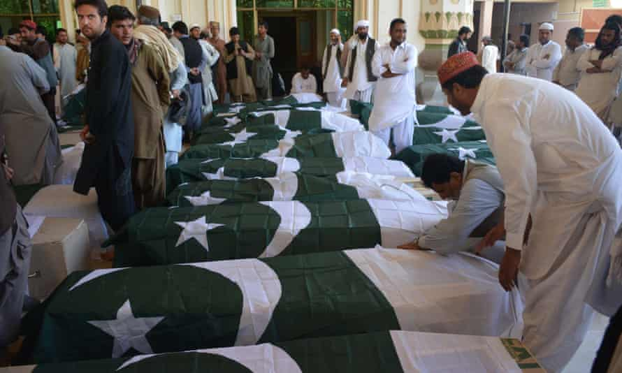 Pakistani mourners gather on Tuesday around the coffins of some of those killed in the attack in Quetta