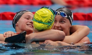 Netherlands' gold medalist Chantalle Zijderveld (left) and silver medalist Lisa Kruger (right) and bronze medalist Keira Stephens of Australia embrace each other after competing in the women's SB9 100m breaststroke final.