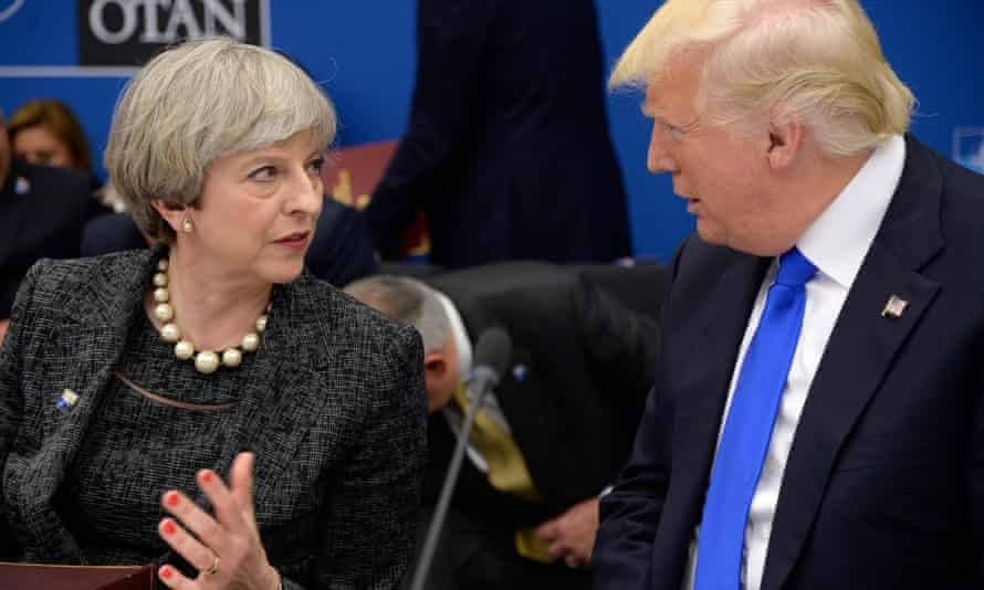 US President Donald Trump (R) speaks with British Prime Minister Theresa May during a working dinner meeting at the NATO (North Atlantic Treaty Organization) summit at the NATO headquarters, in Brussels, on May 25, 2017. / AFP PHOTO / THIERRY CHARLIERTHIERRY CHARLIER/AFP/Getty Images