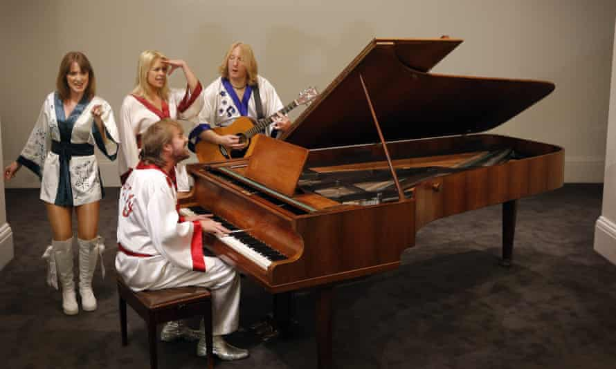 Actors from the Abba tribute show Bjorn Again perfoming with the Georg Bolin piano at Sotheby's auction house in London.