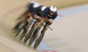 Bradley Wiggins, Owain Doull, Edward Clancy and Steven Burke compete in the men's team pursuit finals track cycling event at the Velodrome.