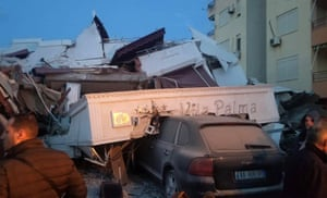 Part of hotel collapsed on top of car