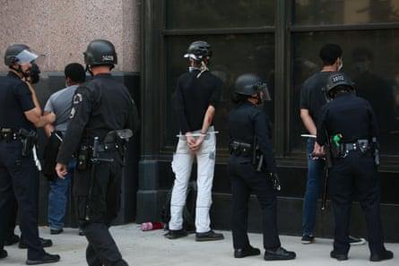 Police in Los Angeles arrest demonstrators as curfew passed on 2 June.