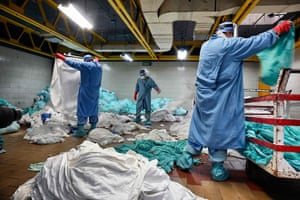 Mexico City, MexicoWorkers handle dirty laundry from the COVID-19 zone, in the laundry room of the Mexican Institute of Social Security (IMSS). - Cleaning workers also risk their lives in Mexico's pandemic hospitals, knowing that their efforts often go unnoticed