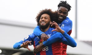 CJairo Riedewald of Crystal Palace is congratulated by teammate Jeffrey Schlupp after opening the scoring.