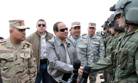 The Egyptian president, Abdel Fatah al-Sisi, meets pilots and aircrew following the the country's air strikes targeting Isis militants in Libya