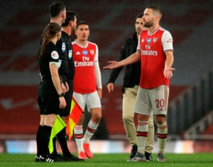 Arsenal's Shkodran Mustafi (right) talks to Referee Chris Kavanagh after the final whistle.
