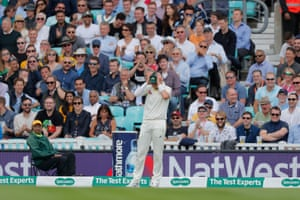 Australia's Peter Siddle looks dejected as the crowd behind him laugh after he dropped a catch from Joe Root.