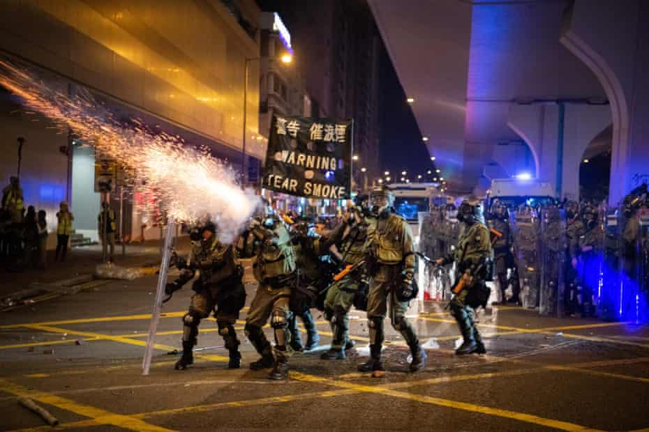 Riot police fire tear gas during a demonstration in the area of Sheung Wan on 28 July