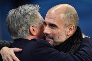 Carlo Ancelotti embraces Pep Guardiola.