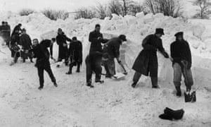 German prisoners of war clearing snow from the Whaley Bridge to Buxton road near Chapel-en-le-Frith, in Derbyshire in 1947.