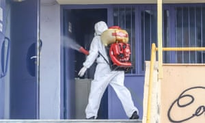 A man in protective suit disinfects a school facility where a child was diagnosed with coronavirus, in ThessalonikiA man in a protective suit disinfects a school facility where a child was diagnosed with coronavirus, in Thessaloniki, Greece, February 27, 2020.