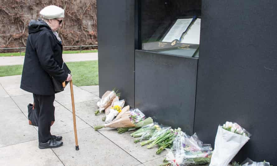 A woman pays her respects at the National Police Memorial, Westminster, on 23 March