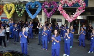 NHS workers and members of the public join the Clap for Carers at Chelsea and Westminster hospital