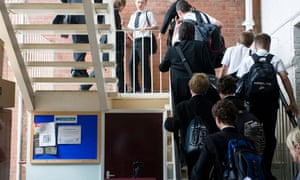 Pupils climb steps at Maidstone Grammar school in Maidstone, Kent, U.K.