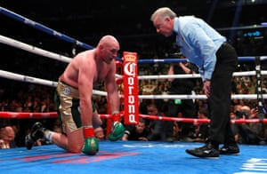 Fury with the referee after being knocked down during the 9th round.