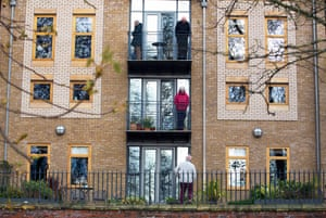 March 2020: older residents in a block of flats along the River Ouse in York talk to each other from their balconies