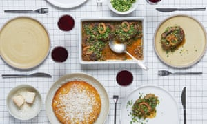 Osso buco feast laid out on a table