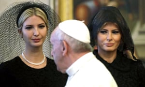 The pontiff walks past Ivanka and Melania Trump.