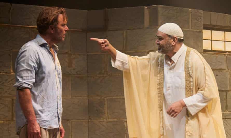 Daniel Lapaine and Tony Jayawardena in The Invisible Hand at the Kiln theatre, London.