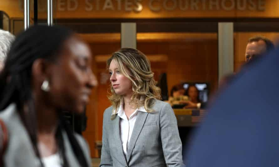 Elizabeth Holmes leaves court in San Jose in 2019.