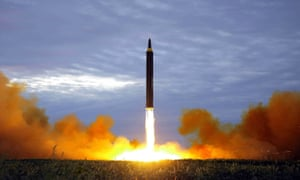 North Korea's intermediate-range strategic ballistic rocket Hwasong-12 lifting off near Pyongyang.