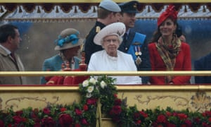 The Queen in the rain on a boat on the River Thames during the diamond jubilee celebrations.