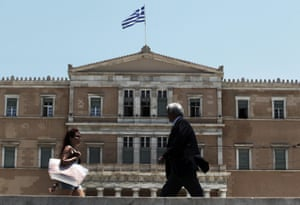 epa04800780 People pass by the Greek Parliament in Athens, Greece, 15 June 2015. European Commission President Jean-Claude Juncker broke off high-level bailout talks with Greek officials on 14 June, after weekend negotiations failed to deliver progress on 'significant gaps' in reform plans for the cash-strapped country. EPA/SIMELA PANTZARTZI